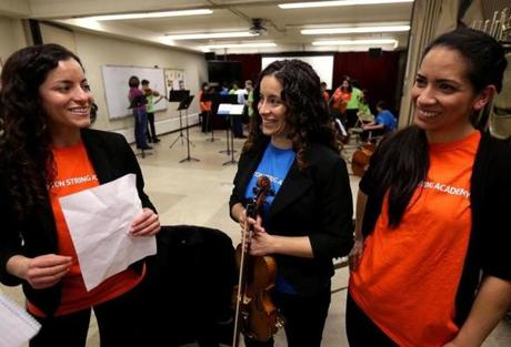 From left: Twin sisters Marielisa and Mariesther Alvarez and Taide Prieto, focounders of the Boston String Academy.